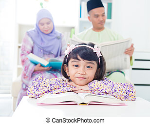 Asian girl reading - Southeast Asian girl reading at home....