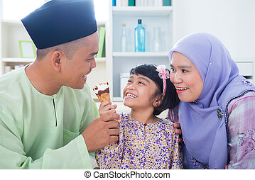 Asian family eat ice cream - Southeast Asian girl feeding...