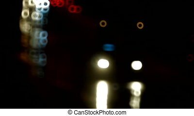 Night traffic on the road - Reflections of car headlights...