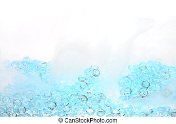 Blue glass pearls and angel's hair on light backround