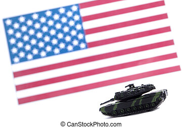 military tracked vehicle in front of usa flag