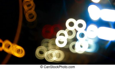 Night traffic - Reflections from the cars. Locked down,...