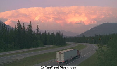 Truck on highway with storm cloud