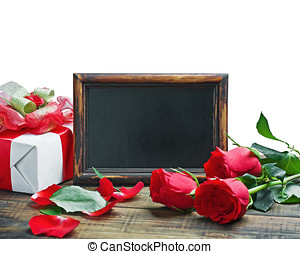 Red roses and gift for Valentine's Day or a birthday on a...
