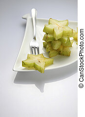 star fruit - slices of the star fruit on the plate