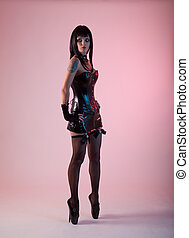Fetish woman in leather corset and extreme ballet shoes