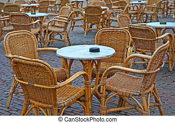 Street Cafe - Wicker Chairs and Tables in a Street Cafe