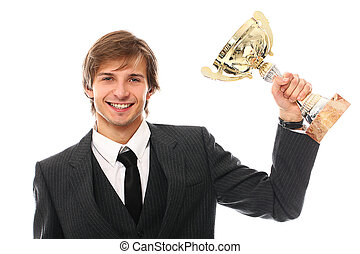 Handsome man in a suit with prize cup over a white...