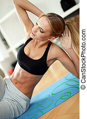 Attractive woman do fitness exercise at home