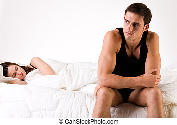 Worried man relation problems - Young adult couple in the...