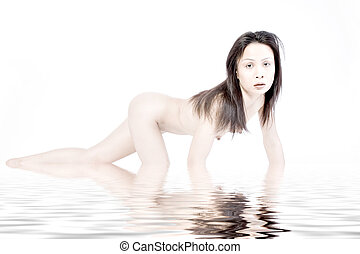 Crawling naked asian woman by water - Studio portrait of a...