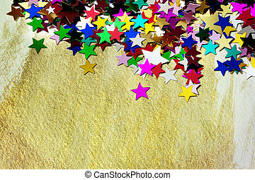 Colorful stars on gold background