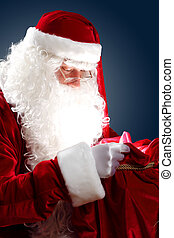 santa claus with his gift bag - Santa Claus with his magic...