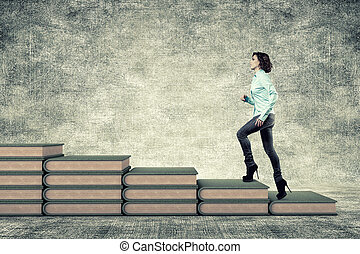 Girl and books - The girl rises upwards on a ladder from...