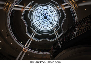Central area and main staircase inside Whiteleys department store. Originally founded by William Whiteley in the late 1800`s and sited in Westbourne Grove, the current store is situated in Queensway.