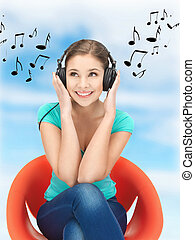 happy teenage girl in big headphones - picture of happy...