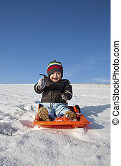 winter holiday fun - boy playing with the snow during the...