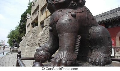 Bronze metal stone lion unicorn China stone arch in front of...
