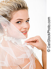 Look of bride - Photo of happy bride touching her veil and...
