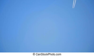 Plane leaves the track in blue sky - The plane leaves the...