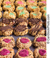 Tray of homemade thumbprint cookies - A tray of decorated...