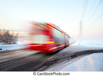 Red bus in blurred motion in winter - Red bus in blurred...