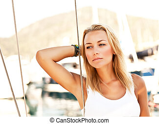 Modeling outdoor - Beautiful woman sailing, young adult lady...