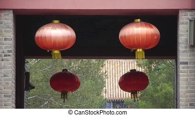 Chinese lanterns.Ancient city Great Wall gate.Historic...