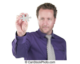 doctor holding a puzzle piece - Doctor holding a puzzle...