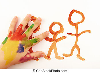 Child's hand covered in paint drawing funny little people