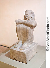 Egyptian statue of sitting man - antique stone Egyptian...
