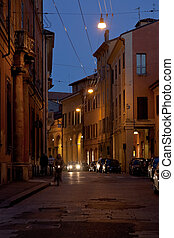 street in historical district of Bologna at night
