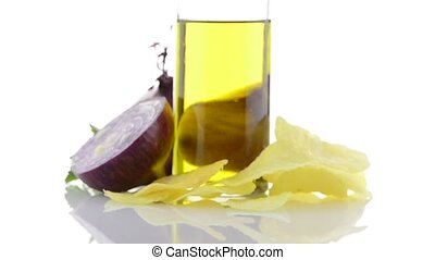 Red onion and olive oil still life rotating isolated on...