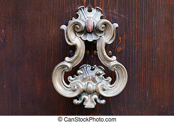 bronze door handle on dark brown door - old bronze door...