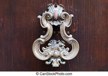 bronze door handle on dark brown door - old bronze door...