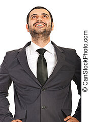 Laughing business man looking up to copy space isolated on...