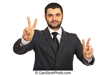 Victorious business man showing victory hands gesture...