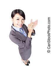 Happy business woman applauding in full length isolated over...