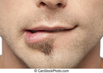 male biting his lips - Close up image of male biting his...