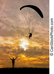 paragliding - Paraglider at sunset
