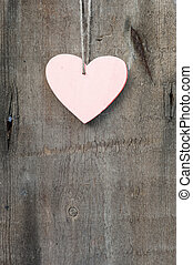 Valentine's Day love heart on rustic style background -...