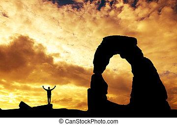 Rock climber at sunset