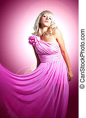 Beautiful blonde in pink with a flower. Barbie doll. -...