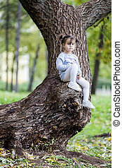 Little girl on the tree