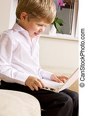 communicative youngster - picture of happy boy with white...