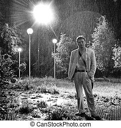Sad man in the rain