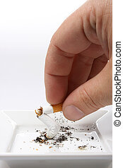 stop smoking - Hand stubbing out a cigarette on white...