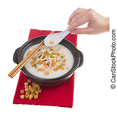 Traditional chinese scallop porridge rice gruel served in...