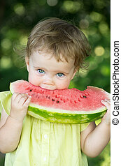 baby girl - cute little baby girl eating watermelon slice