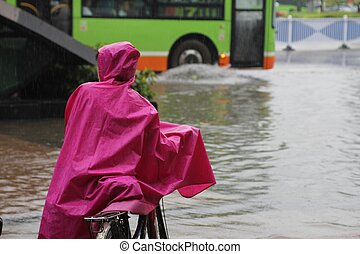 Girl stranded in flooding water during heavy rains - Girl...
